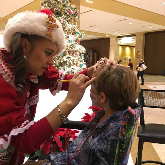 Getting his face painted