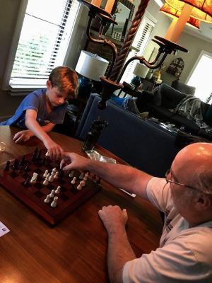 Beck and Grandpa playing chess