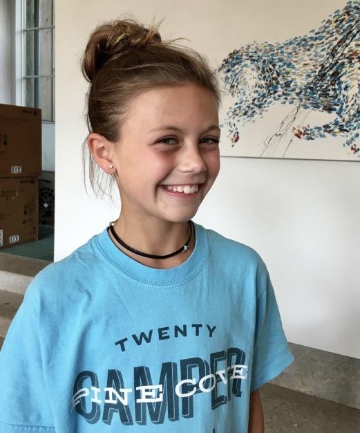 Elle with newly pierced ears