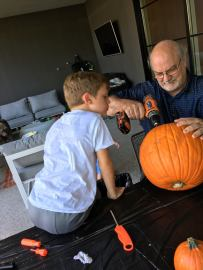 Grandpa & Beck cleaning out the inside of the pumpkin