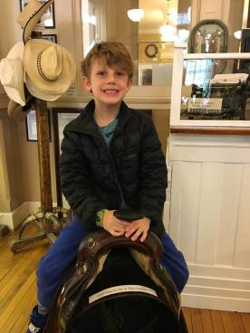 Beck trying out a saddle in the museum