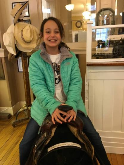 Ally trying a saddle in the museum