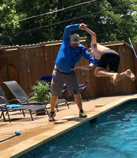 Corey throwing Aidan in the pool