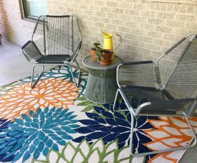 New porch rug with gift cards from kids