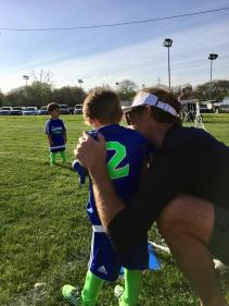 Miles giving Jack some soccer advice